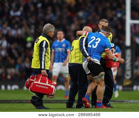 LONDON, ENGLAND - MARCH 09 2019: Tommaso Castello of Italy is helped off the field during the Guinness Six Nations match between England and Italy at Twickenham Stadium