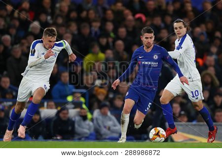 LONDON, ENGLAND - MARCH 7 2019: Jorginho of Chelsea  runs with the ball during the Europa League match between Chelsea and Dynamo Kyiv at Stamford Bridge.