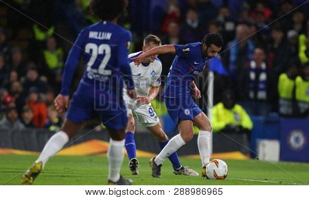 LONDON, ENGLAND - MARCH 7 2019: Willian and Pedro of Chelsea during the Europa League match between Chelsea and Dynamo Kyiv at Stamford Bridge.