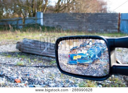 A Wrecked Car Is Visible In The Side Mirror Of Another Wrecked Car At The Abandoned Furber's Scrapya