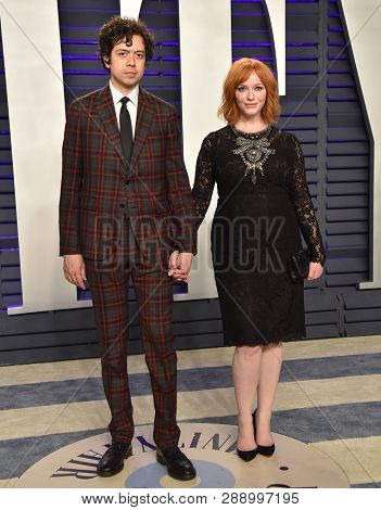 LOS ANGELES - FEB 24:  Geoffrey Arend and Christina Hendricks arrives for the Vanity Fair Oscar Party on February 24, 2019 in Beverly Hills, CA