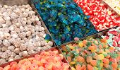 many colorful and sugary candies in the candy store poster