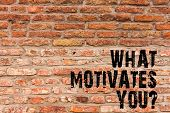 Handwriting text writing What Motivates Youquestion. Concept meaning Passion Drive Incentive Dream Aspiration Brick Wall art like Graffiti motivational call written on the wall. poster