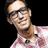 portrait of young man with shirt and glasses over a black background poster