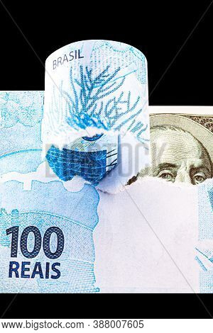 Detail Of A Banknote Of 100 Reais From Brazil Beside A Hundred Dollar Bill Of American Dollars, Gloo