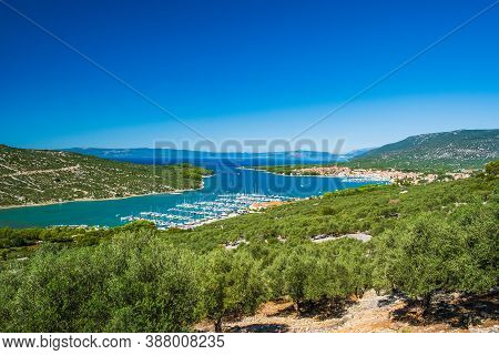 Panoramic View Of Adriatic Seascape, Blue Bay And Town Of Cres On The Island Of Cres In Croatia