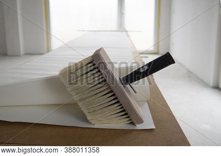 Wide Paint Brush For Glue With Wooden Base For Bristle,black Handle,several Sheets Of White Wall Pap