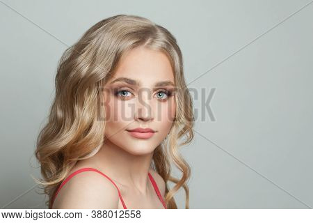 Pretty Model Portrait. Cute Woman With Long Blonde Hairstyle On White