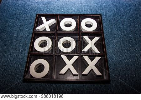 Abstract Large Tic-tac-toe Game Board Against Blue Denim Background