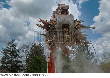 Dismantling An Old House, Bulldozer Destroys Of The Demolition Of A Building Under Construction Of A