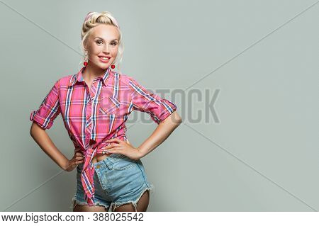 Attractive Pin-up Woman Posing On Gray Banner Background