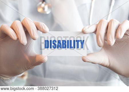 Doctor Holding A Card With Text Disability