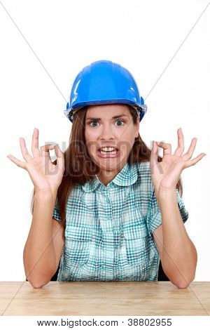 Woman with helmet and face of disgust