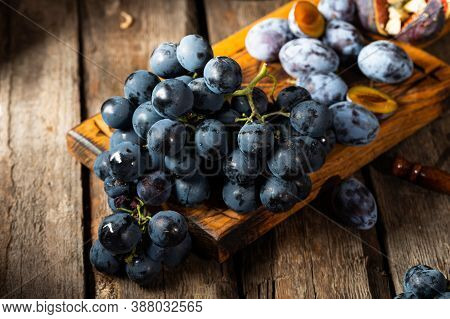 Grapes On A Old Wooden Table. Blue Grape. Black Grape. Vine Grape. Still Life Of Food.