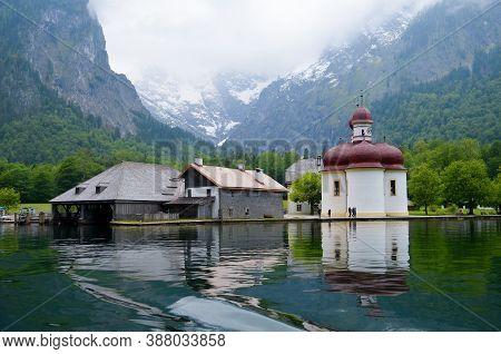 Berchtesgaden, Bavaria, Germany -05.25.2013: Royal Lake Königssee And St. Barthalomew's Church.