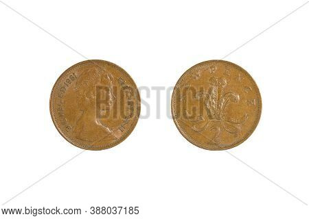Close Up Of One New Old Bronze British 2 Pence, Front And Back. Isolated On White.