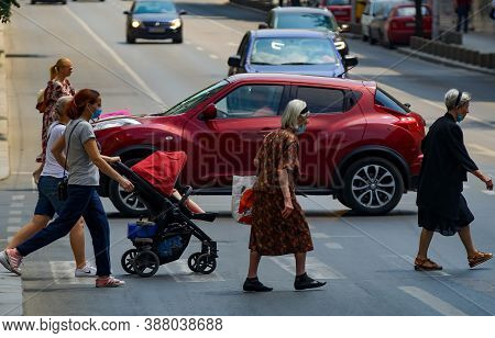Bucharest, Romania - June 30, 2020: Pedestrians Cross The Street On Regina Elisabeta Boulevard In Bu