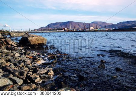 Polluted Lake Shore In The City Of Norilsk. Environmental Pollution.