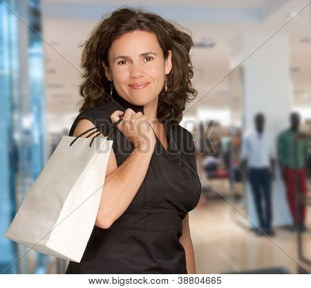 Mediterranean looking woman shopping at the mall