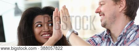 Portrait Of Cheerful Happy Couple Giving High Five And Smiling. Middle-aged Man And Latino American