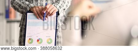 Close-up Of Boss Female Wearing Presentable Stylish Suit And Holding Clipboard With Report. Developm