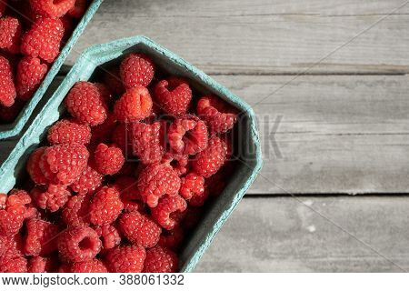 Fresh Red Raspberries In Craft Stalls, Containers. On A Wooden Rustic Old Background. Top View Of Ri
