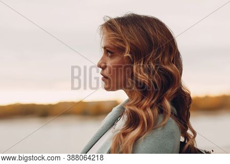 Portrait Profile Of Attractive Young Woman Outside