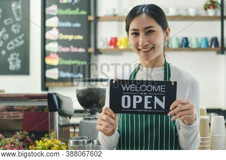 Attractive Young Asian Women Smiling And Confident In Cafe. Young Female Barista, Owner Coffee Shop,