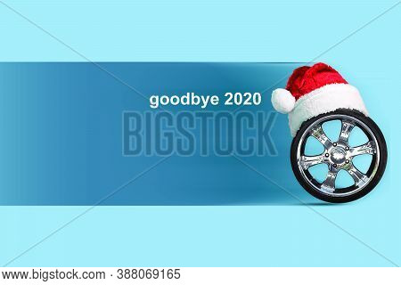 Goodbye 2020. Wheel In Santa Hat. Farewell To The Passing Year. Festive Background.