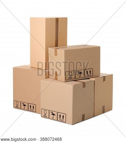 Parcel Delivery. Cardboard Boxes With Different Packaging Symbols On White Background