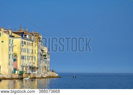 Part Of The Old Town Of Rovinj In Crotia And The Adriatic Sea