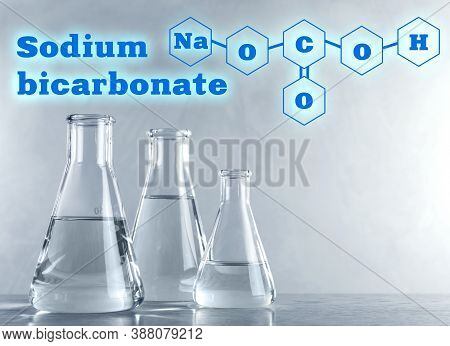Text Sodium Bicarbonate With Soda Formula And Laboratory Glassware On Background