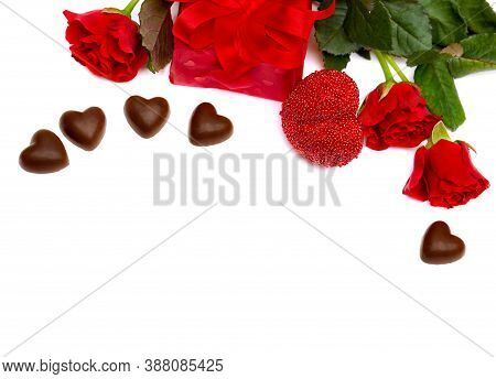 Valentine's Composition With Red Roses, Chocolaty Candy, Gift Box And Hearts On White Background Wit