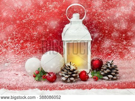 Christmas Decoration. Christmas Lantern, White And Red Balls, Pine Cones, Red Apples, Twigs Of Red B