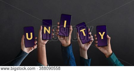 Unity Concept. Group Of People Making Unity Text On Smartphone. Power Of Online Community Via Social