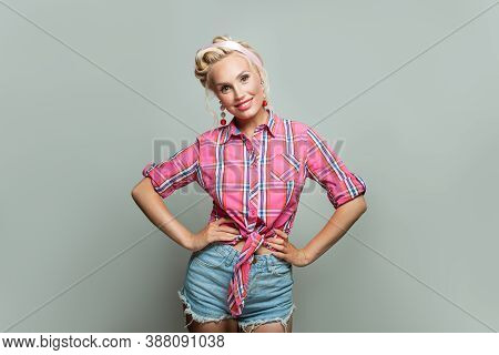 Pin Up Woman Smiling On Gray Background