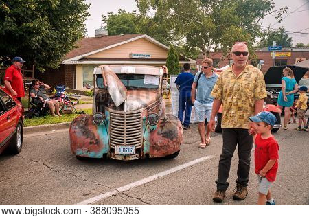 Toronto, Canada - 08 18 2018: Visitors Of The Open Air Auto Show Wheels On The Danforth Beside Oldti
