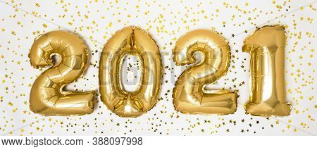 Golden 2021 Balloons. Gold Metallic Foil Numbers For Happy New Year Celebration On White Background