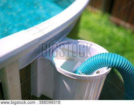 Closeup Of A Swimming Pool Skimmer And Water Hose, Shallow Dof
