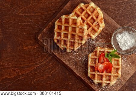 Fresh Hot Belgian Waffles On Cutting Board