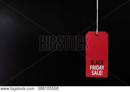 Black Friday Sale Concept. Red Sale Tag Color On The Black Background With Copy Space.black Friday W