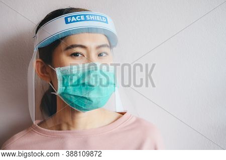 Asian Woman Wearing Mask And Face Shield Before Going Outside For Prevent And Protection Covid-19 Vi