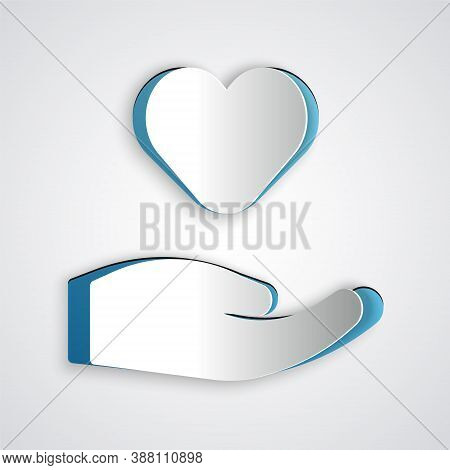 Paper Cut Heart In Hand Icon Isolated On Grey Background. Hand Giving Love Symbol. Valentines Day Sy