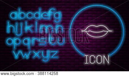 Glowing Neon Line Smiling Lips Icon Isolated On Brick Wall Background. Smile Symbol. Neon Light Alph