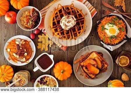 Autumn Breakfast Or Brunch Buffet Table Scene Against A Dark Wood Background. Pumpkin Spice, Waffles