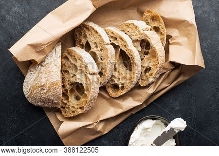 Slices Of Fresh Rye Ciabatta From A Bakery Or Market On A Paper Craft Bag With Cottage Cheese Or Cre