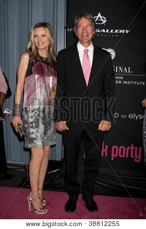 """LOS ANGELES - OCT 26:  Michelle Pfeiffer, David E. Kelley arrives at """"The Pink Party '12"""" at Hanger 8 on October 26, 2012 in Santa Monica, CA"""