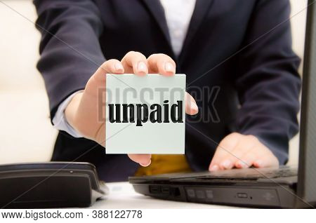 Girl Holding A Card With The Words Unpaid. Financial Loss. Bankrupt. Business Decline. High Quality