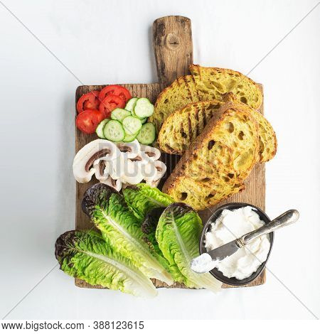 Crispy Appetizing Grilled Toast With Ingredients For A Sandwich Green Lettuce, Mushrooms, Sour Chees