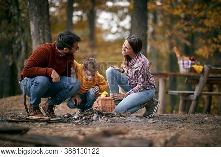 Happy mom and dad camping with peschool son
